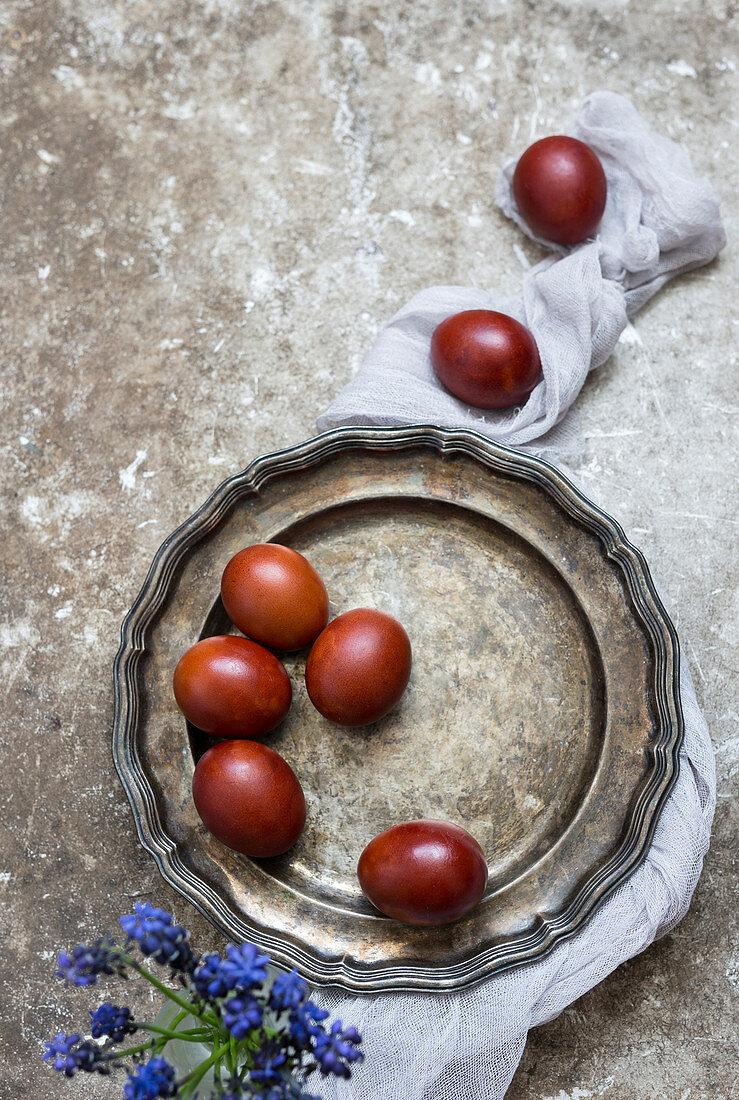 Coloured eggs on a tin plate