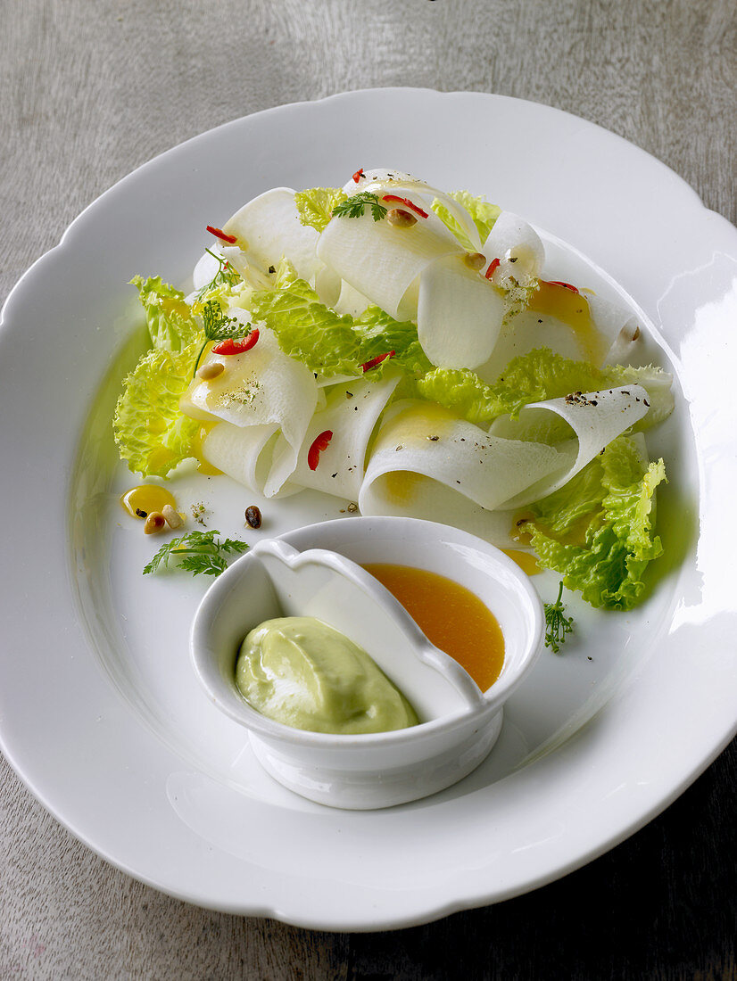 Radish strips with lettuce, chervil, avocado cream and olive oil