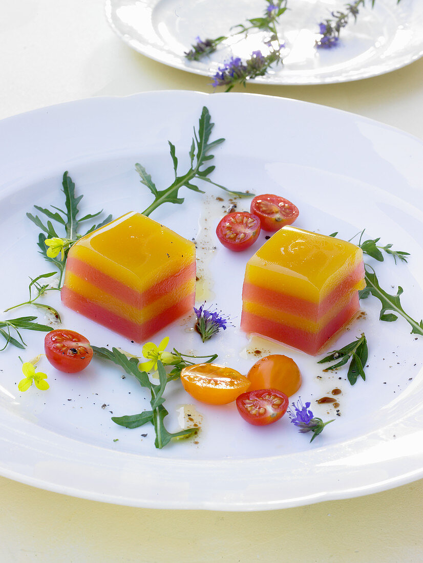 Red and yellow tomato terrine with hyssop and rocket