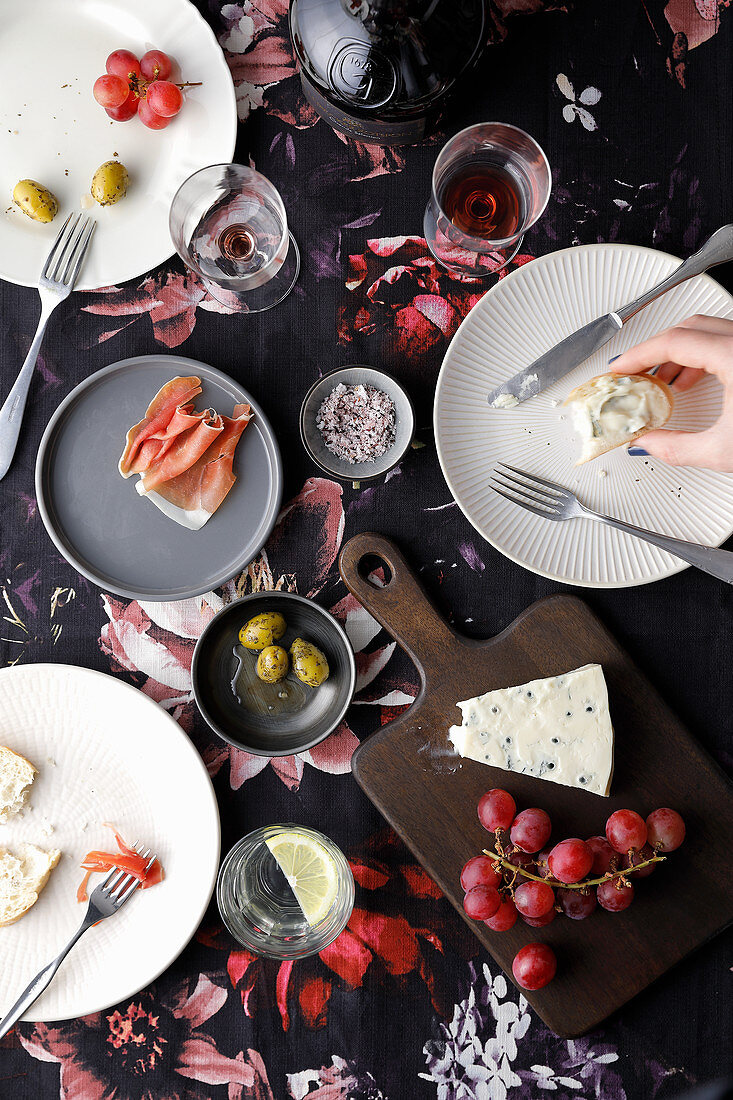 A dinner scene with antipasti and wine