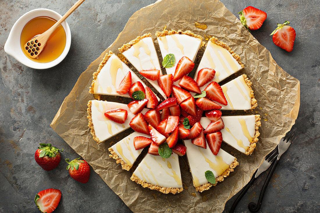 Fresh yogurt tart with macerated strawberries, mint and honey