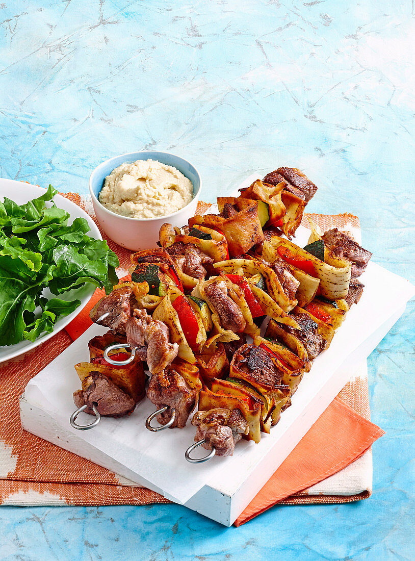 Mediterranean skewers with lebanese bread, lamb and bell pepper