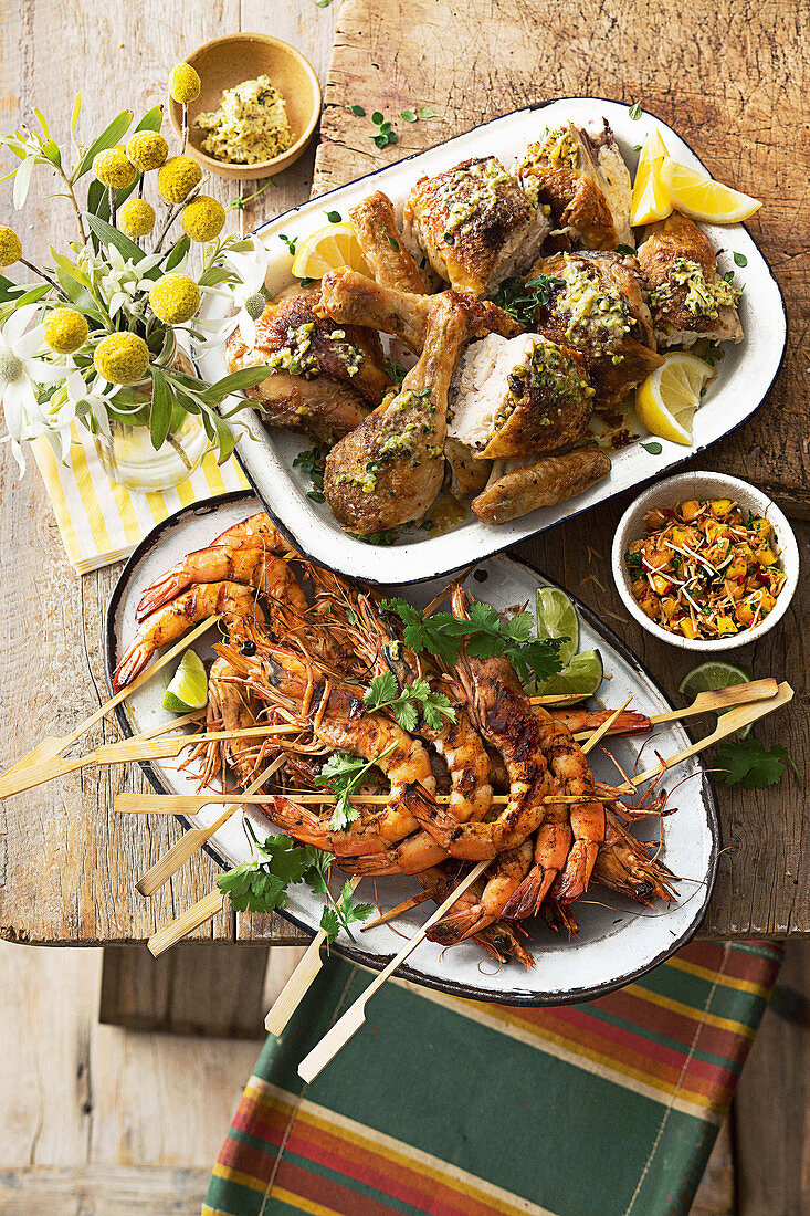 Cajun prawns with mango, lime and coconut salsa, Butterflied chicken with pistachio butter