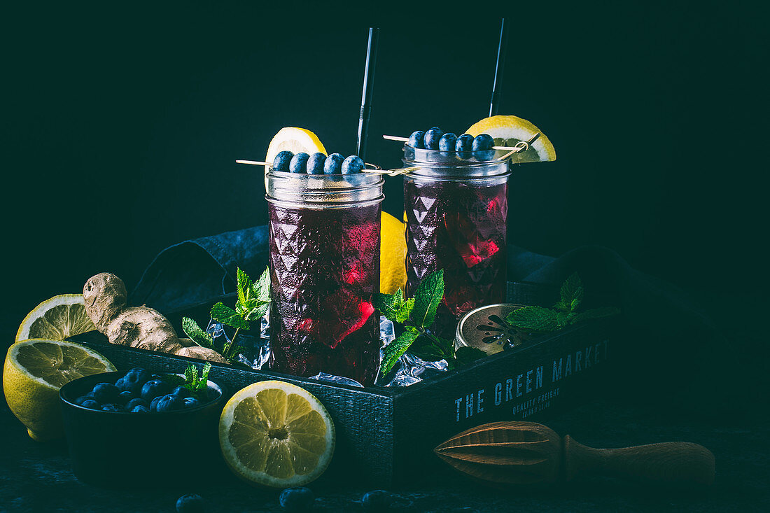 Blueberry switchel (a diet drink with apple cider vinegar and ginger) on a tray