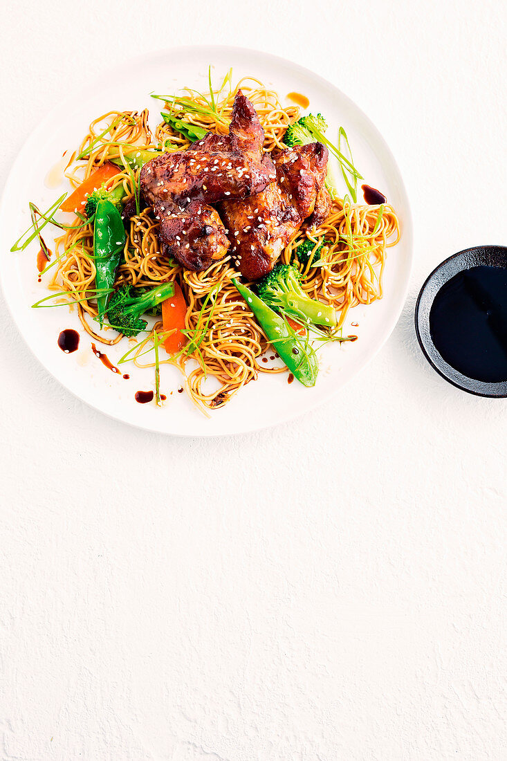 Asian chicken wings with noodles