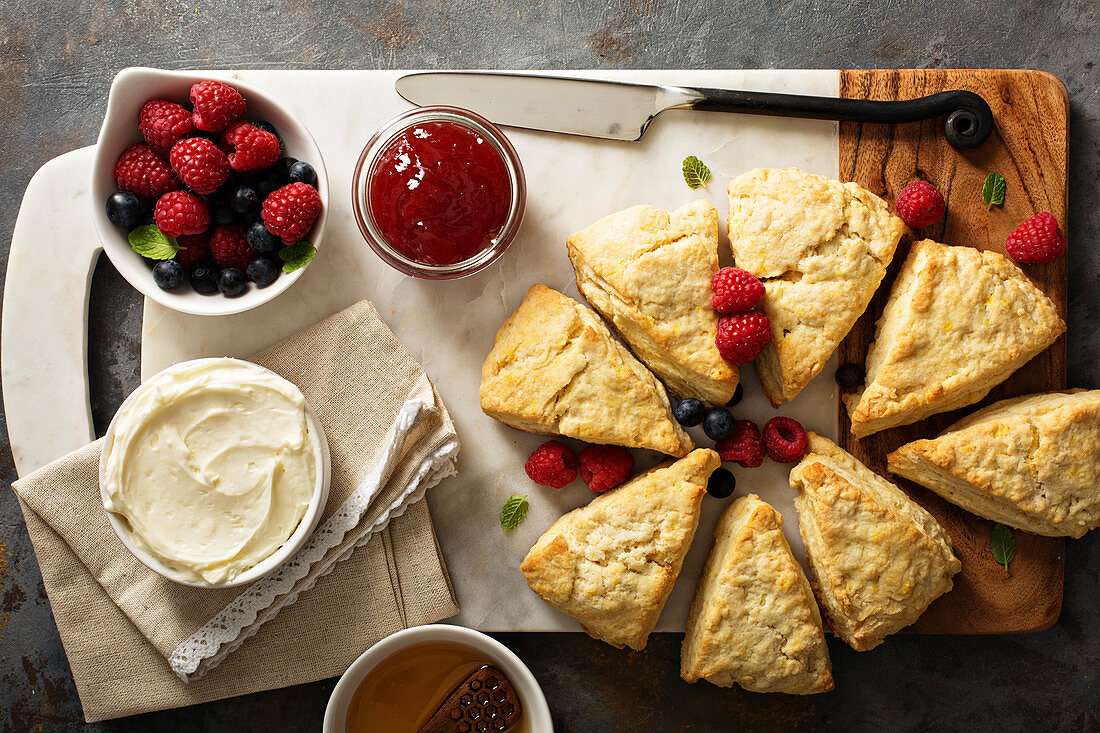 Scones served with cream cheese and berries (top view)