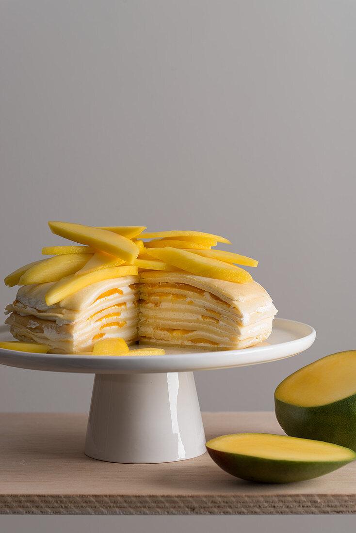 Mille Crepes cake (pancake cake) with cream and mango