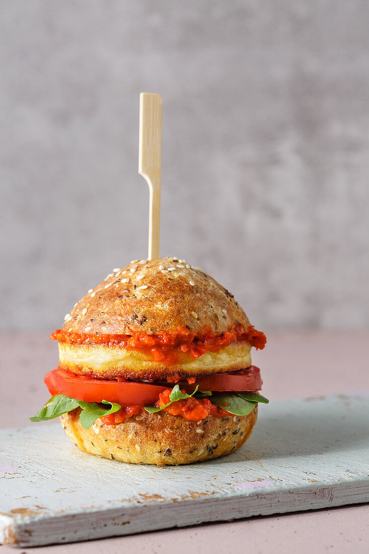 Low-carb sesame seed and grilled cheese burger with ajvar
