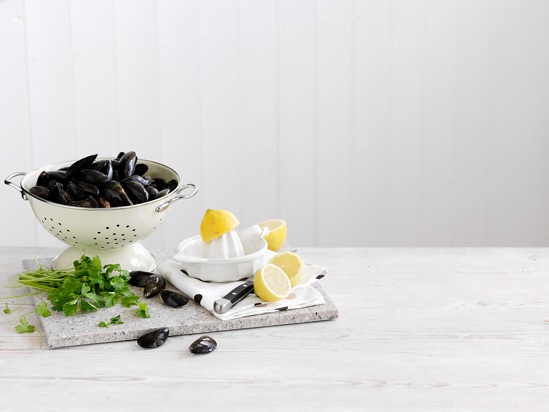 Mussels and lemons on a chopping board