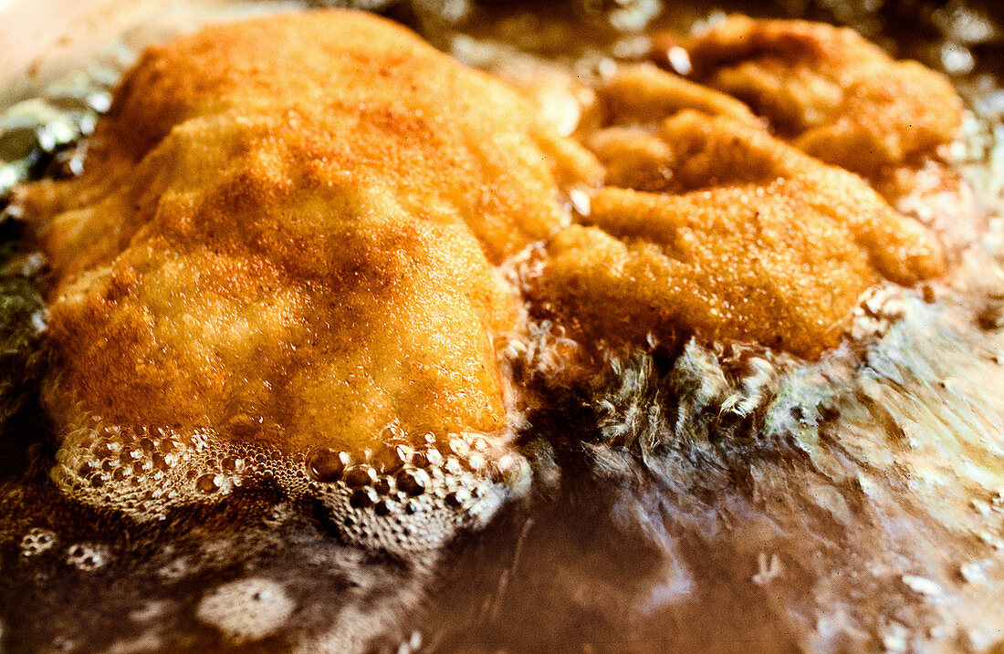 Viennese escalopes being fried
