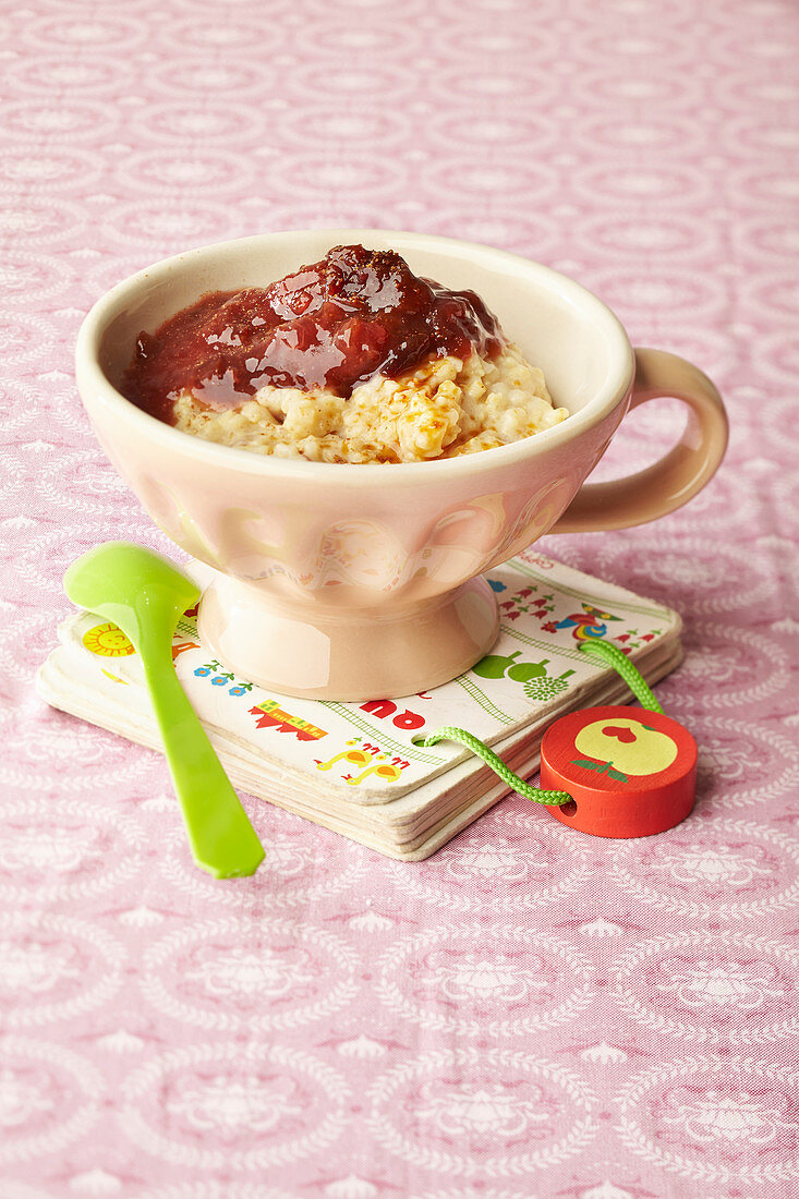 A cup of millet pudding with plum mousse for children