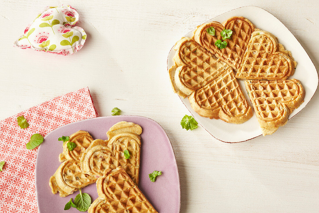 Ham and herb waffles on plates