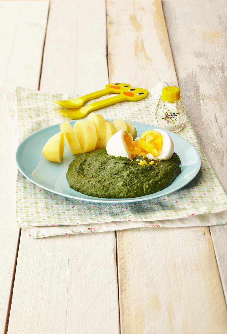 Spinach with a hard-boiled egg and potatoes for children
