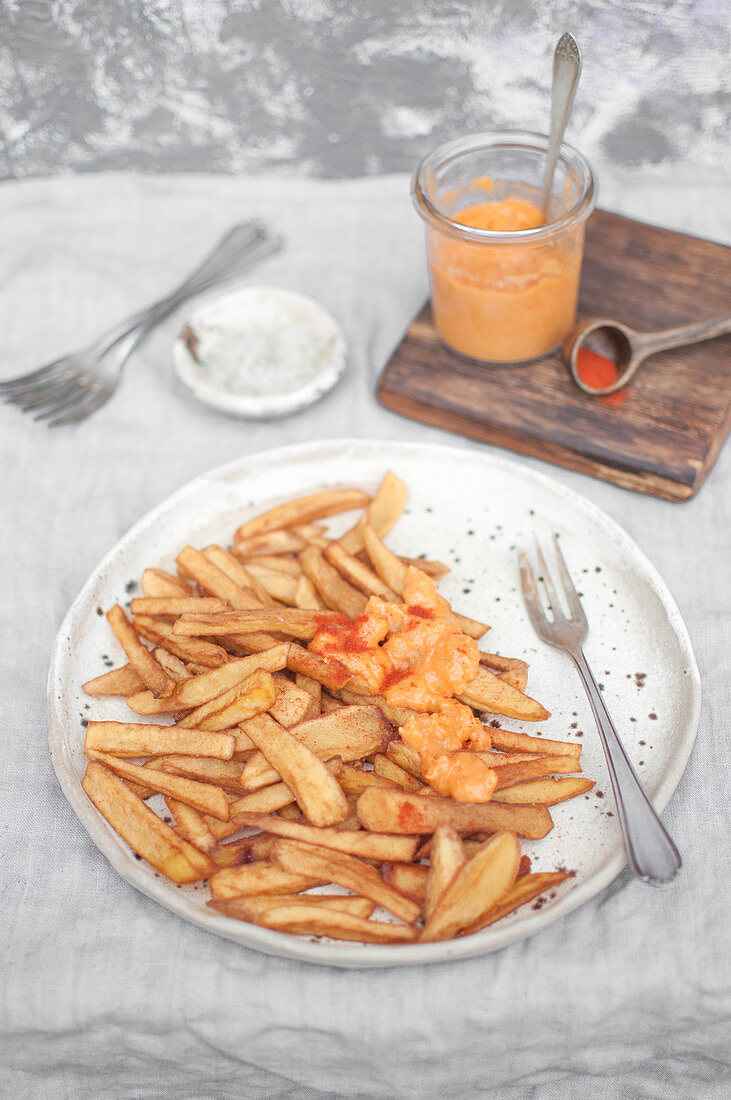 Homemade french fries served with cheese sauce