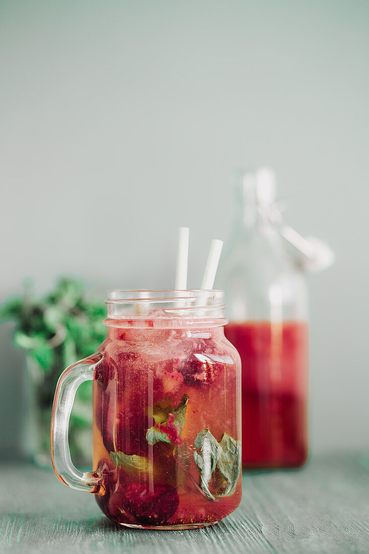 A refreshing drink with wild berries and mint