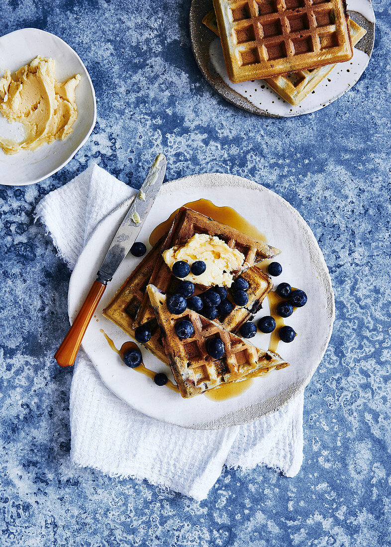 Glutin free blue berry waffles, drizzled with maple syrup and maple butter