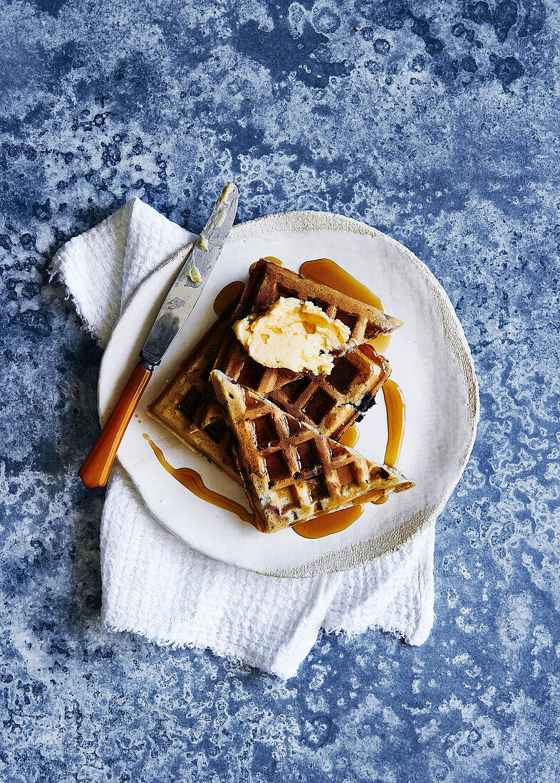 Glutin free blueberry waffles, drizzled with maple syrup and maple butter