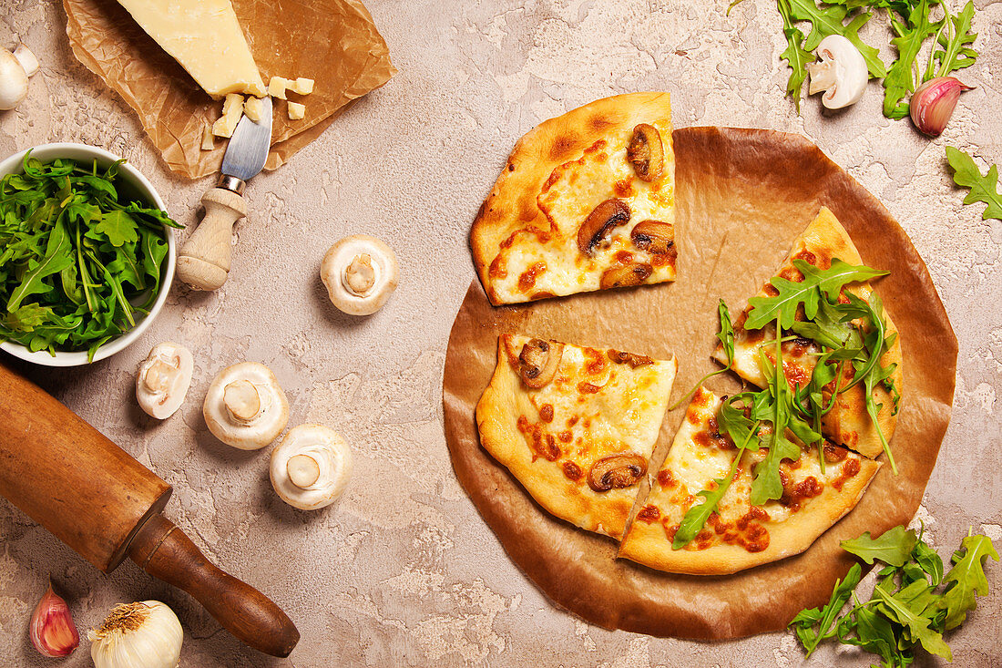 Veggie Pizza with ingredients on old stone background