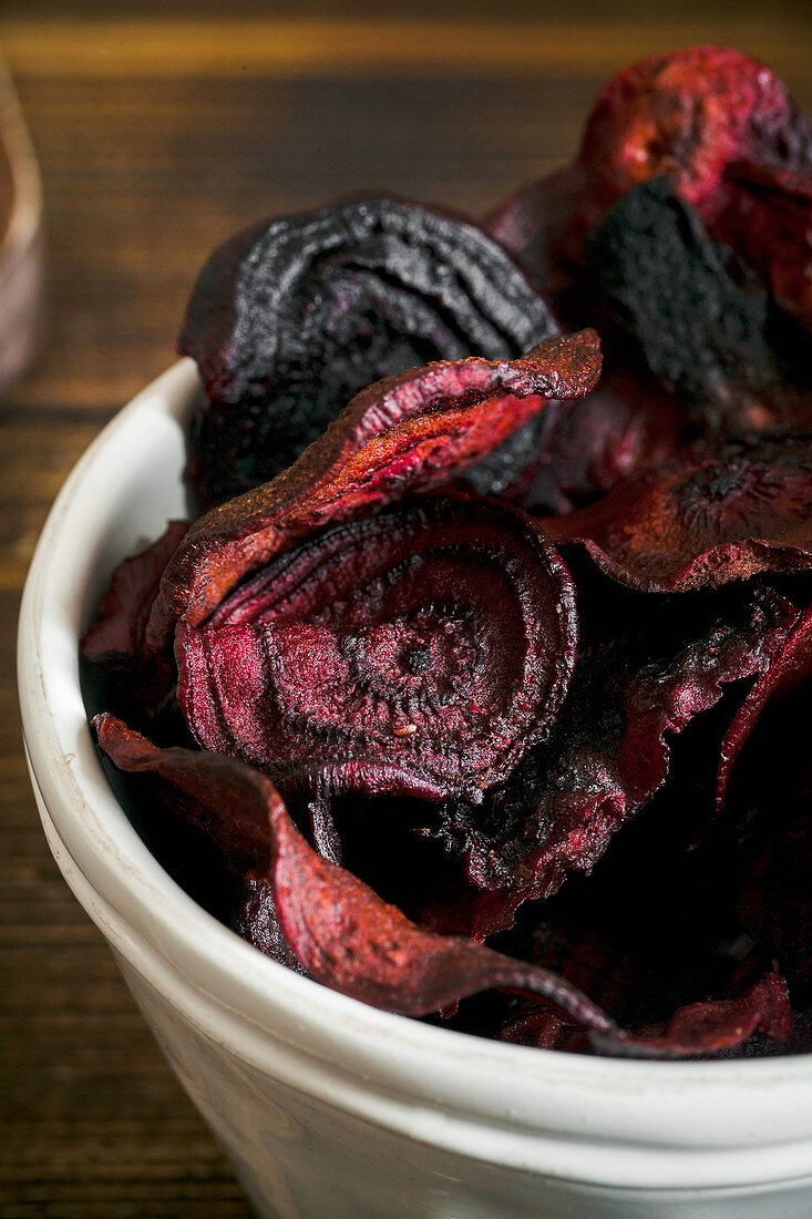 Organic homemade beetroot chips cooked in oven with olive oil, pepper and salt