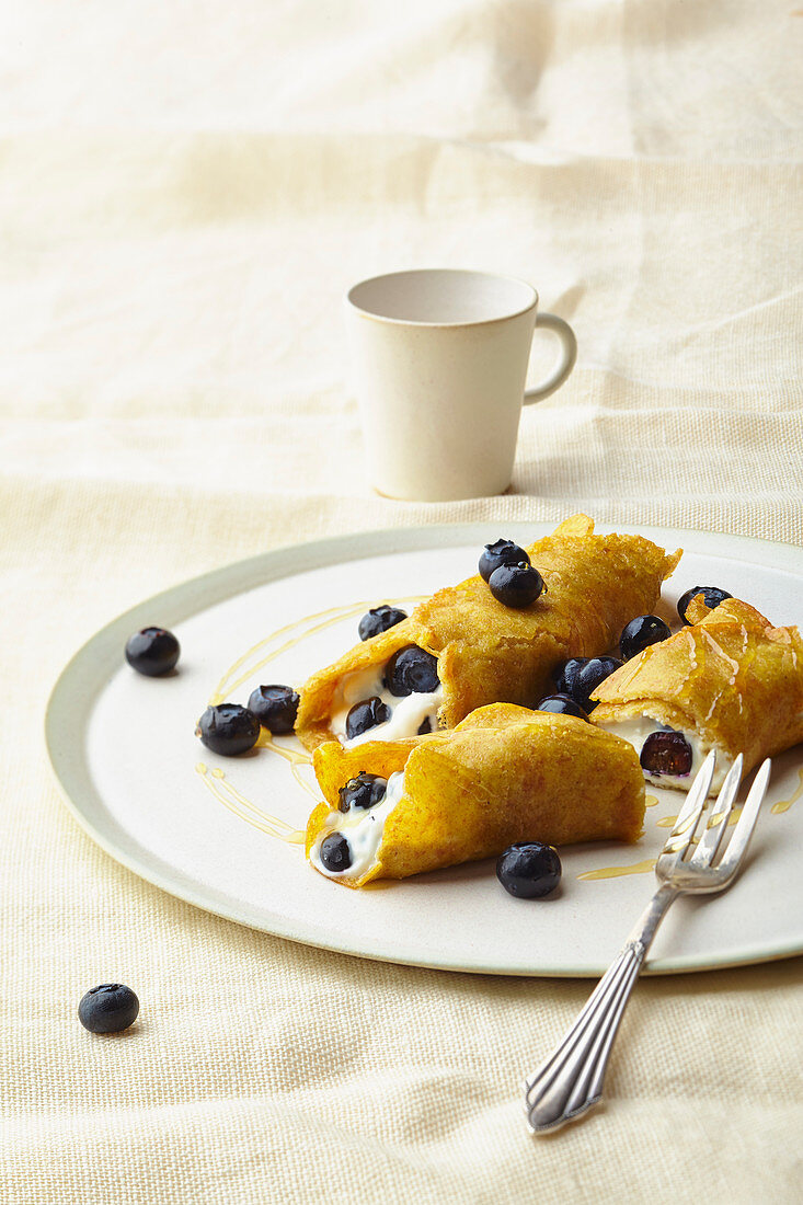 Pancakes filled with blueberries and quark