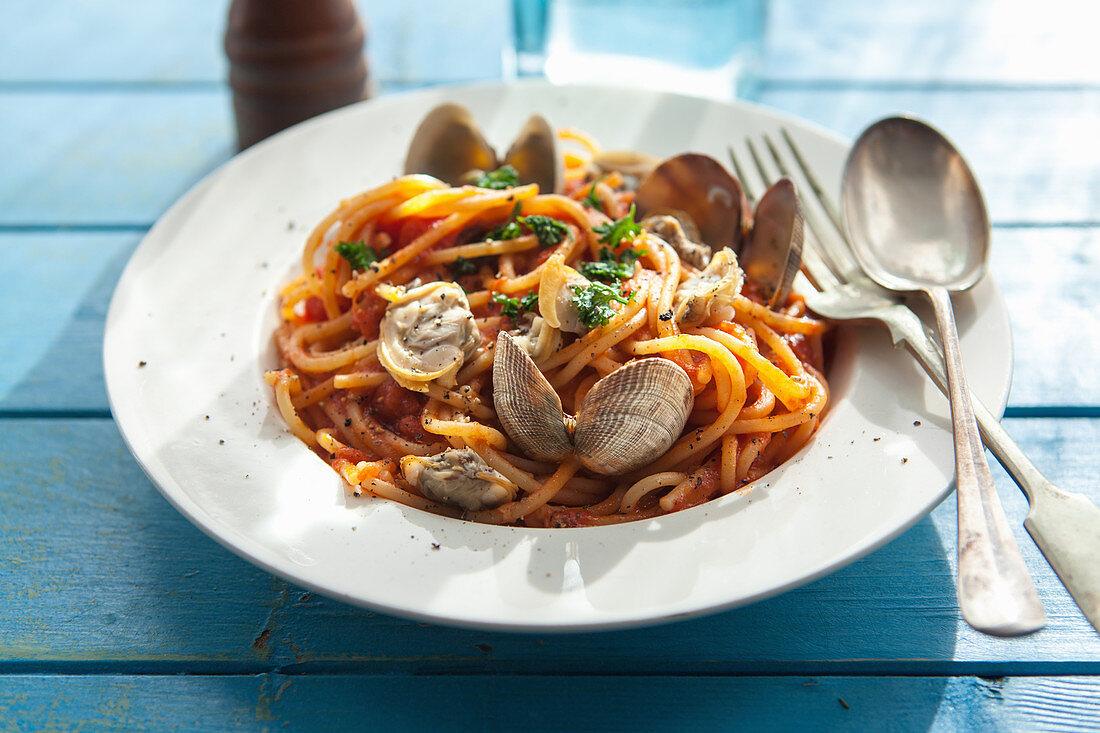 Spaghetti made with a tomatoe and clam sauce.