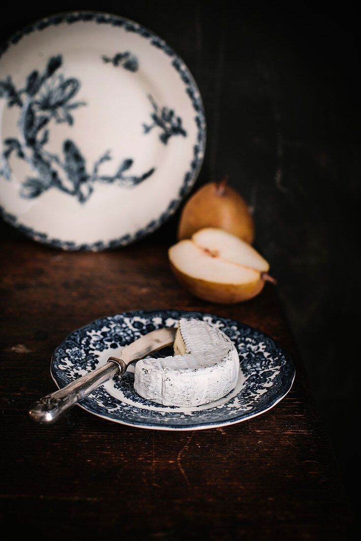 Still life with cheese and pear