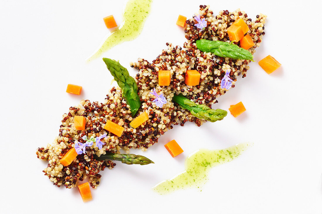 Quinoa steamed and sauteed in a pan with asparagus and carrots