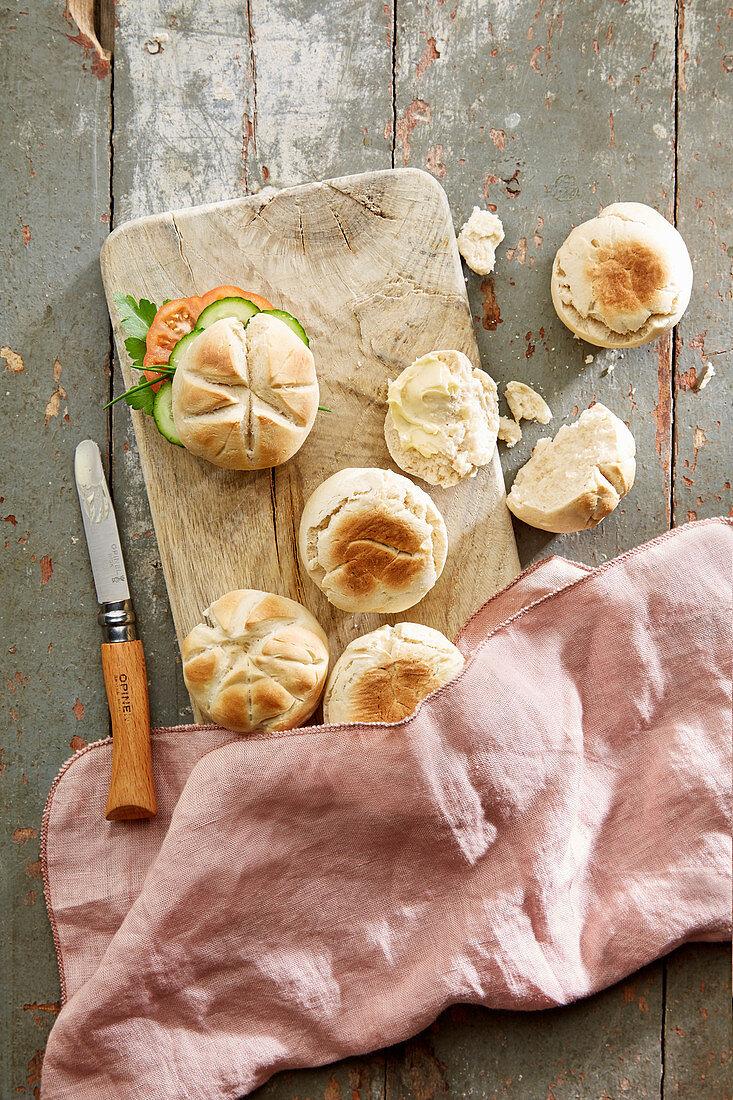 Bread rolls on a wooden board