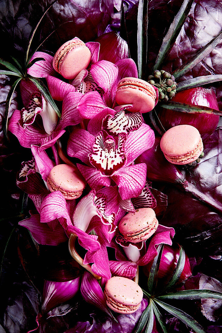 An arrangement of pink shades made from flowers, vegetables and macaroons (full frame)