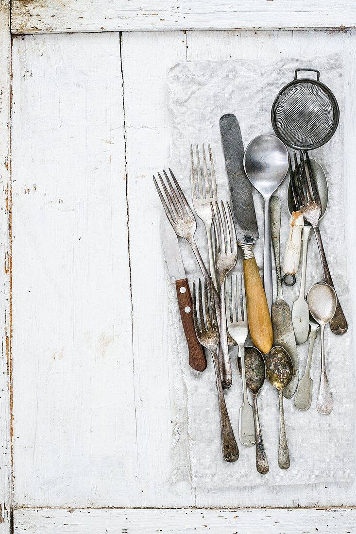 Vintage cutlery on a white surface