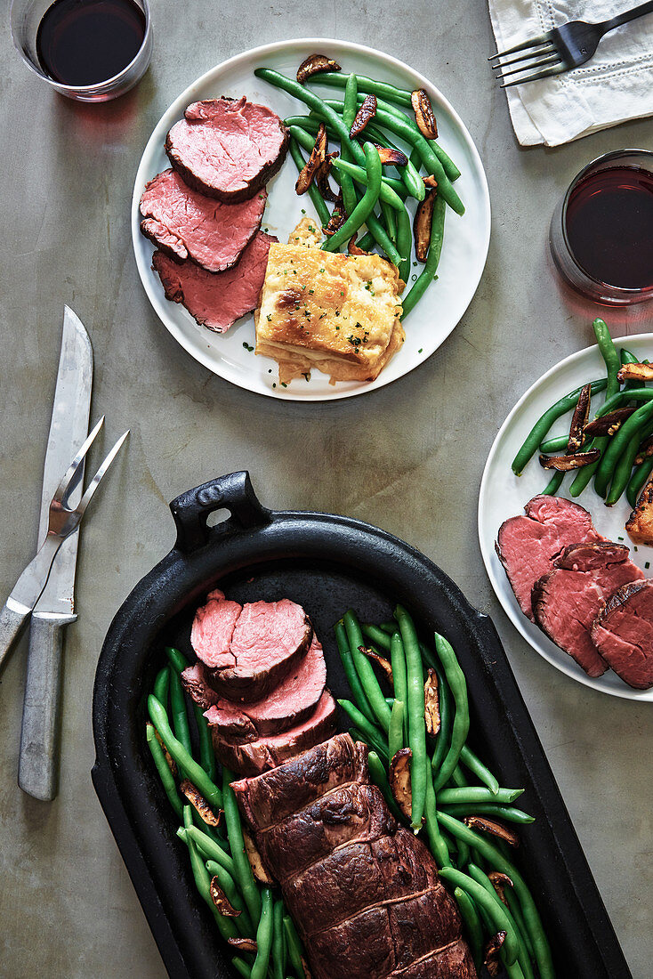 Beef fillet with potato gratin, green beans and mushrooms