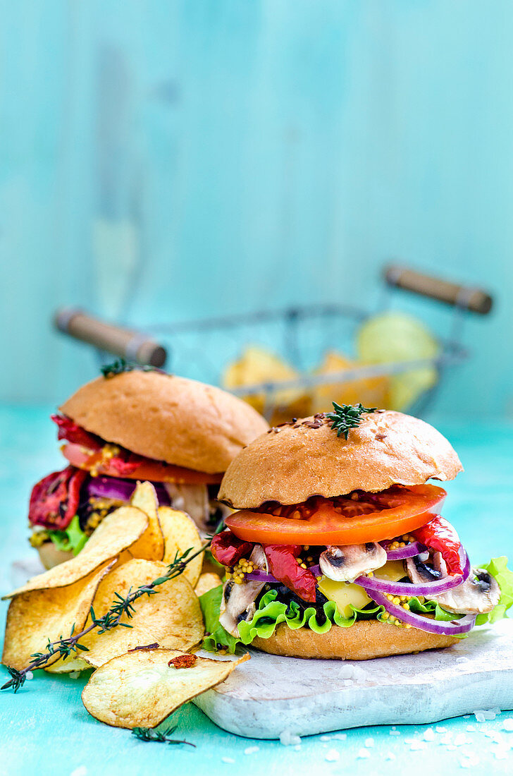 Burgers and potato chips on a blue background
