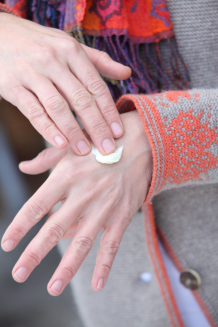 Lanolin being rubbed into hands