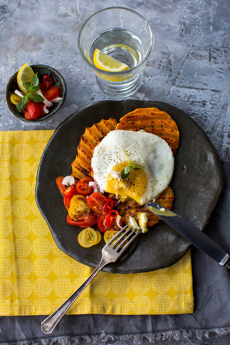 Butternut waffles with a fried egg and tomato salsa