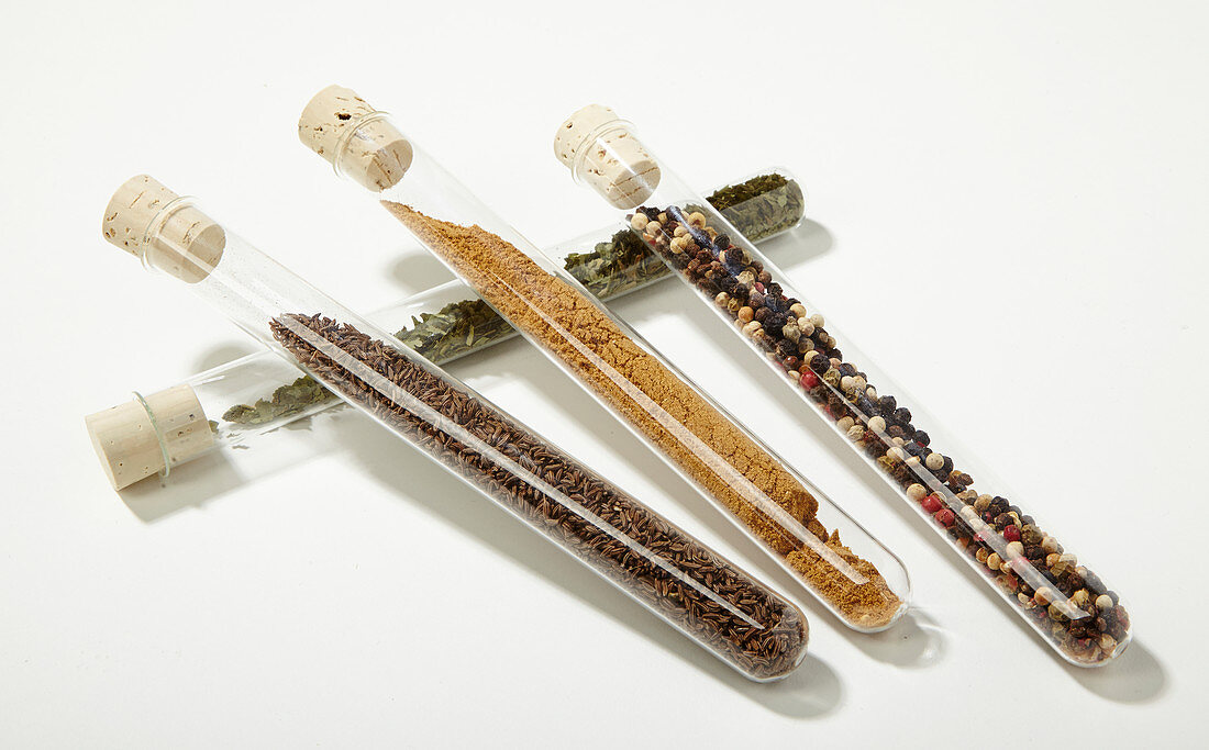 Various spices in test tubes with cork stoppers