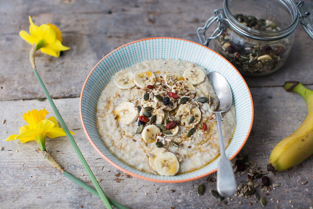 Breakfast bowl of porridge topped with banana seeds