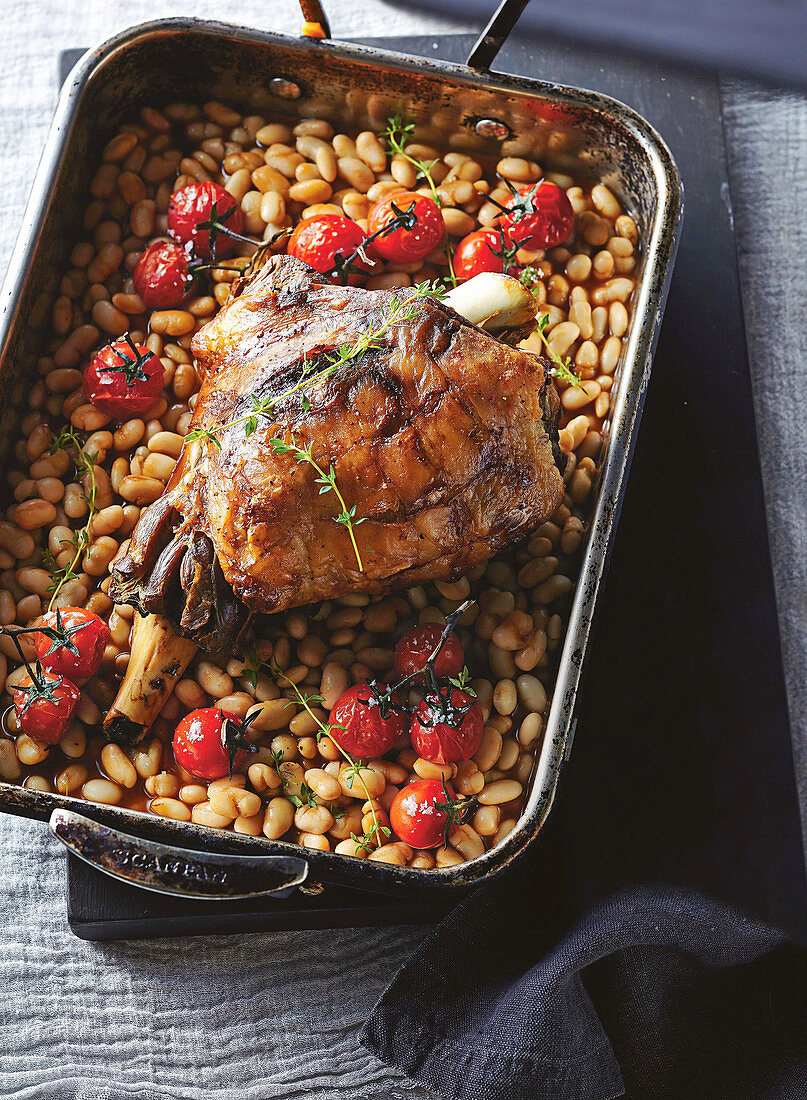 Slow-roasted lamb with white beans