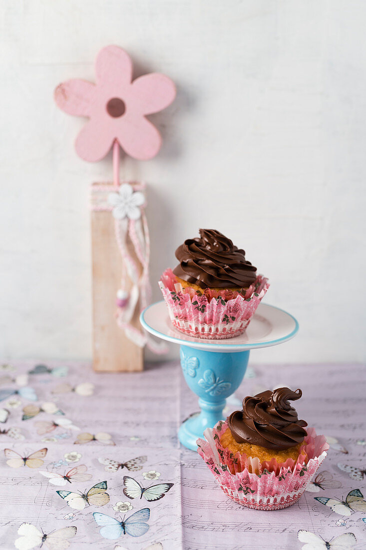 Cupcakes topped with chocolate cream