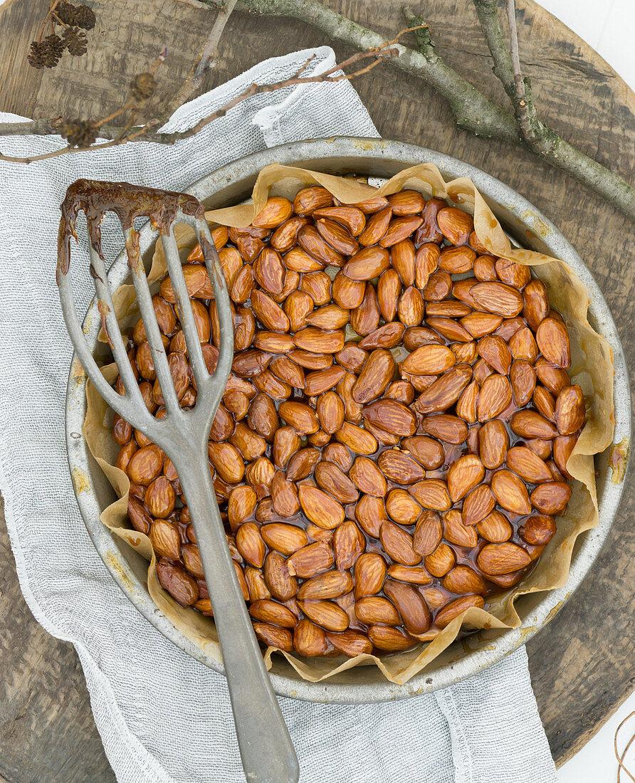 Almond brittle in a round baking dish