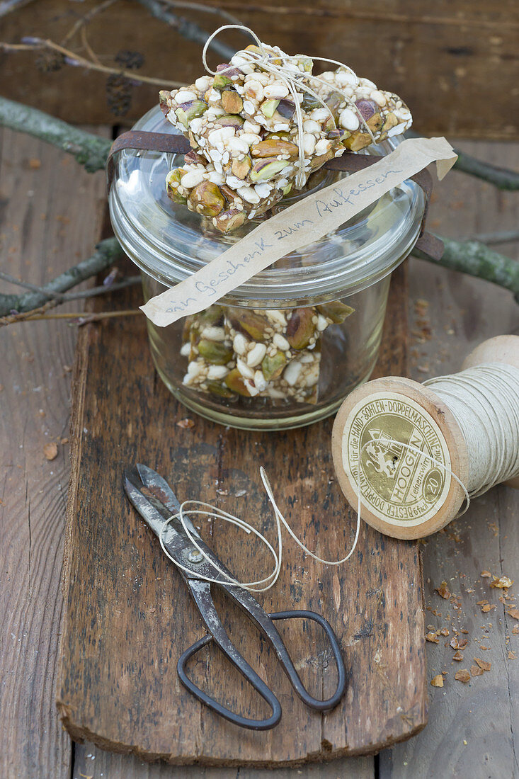 A muesli bar with pistachios, sunflower seeds and sesame seeds for gifting