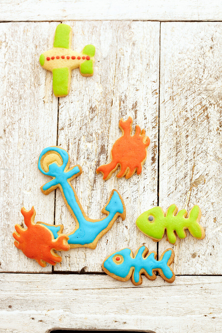 Colorful biscuits in the form of fish, anchors, crabs and an airplane