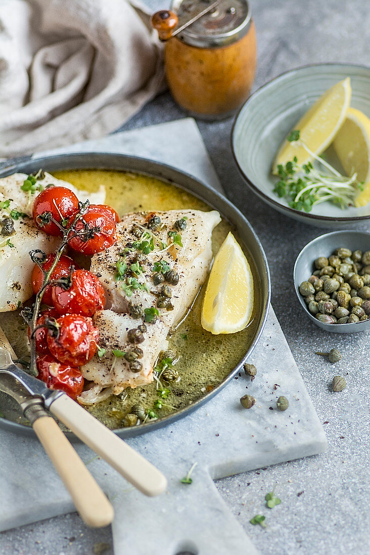 Baked haddock with tomatoes and capers