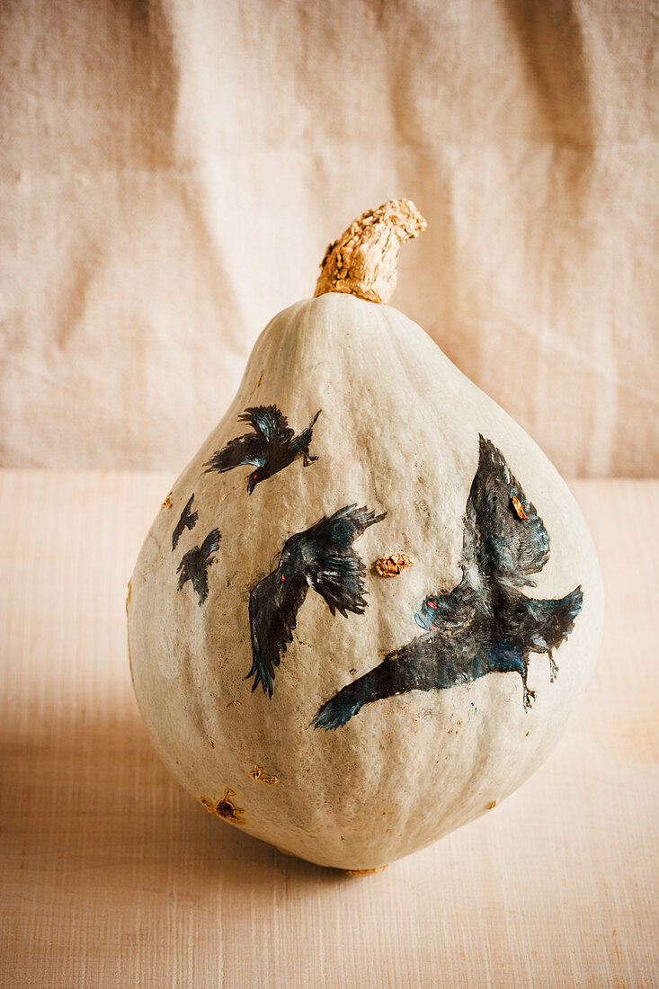 Pumpkin painted with ravens