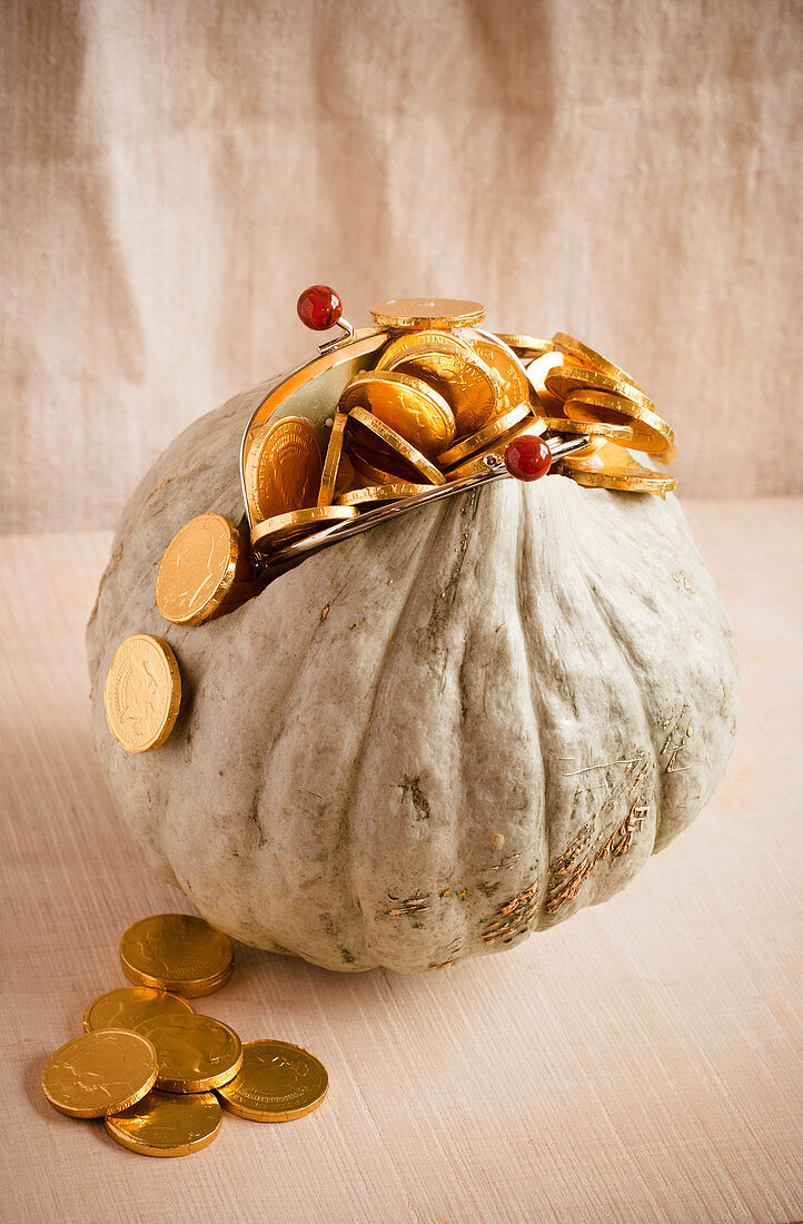 Pumpkin decorated to look like purse