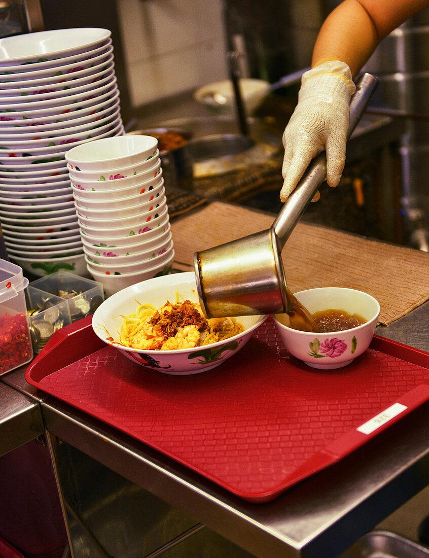 A pasta dish in a restaurant kitchen (Singapore)