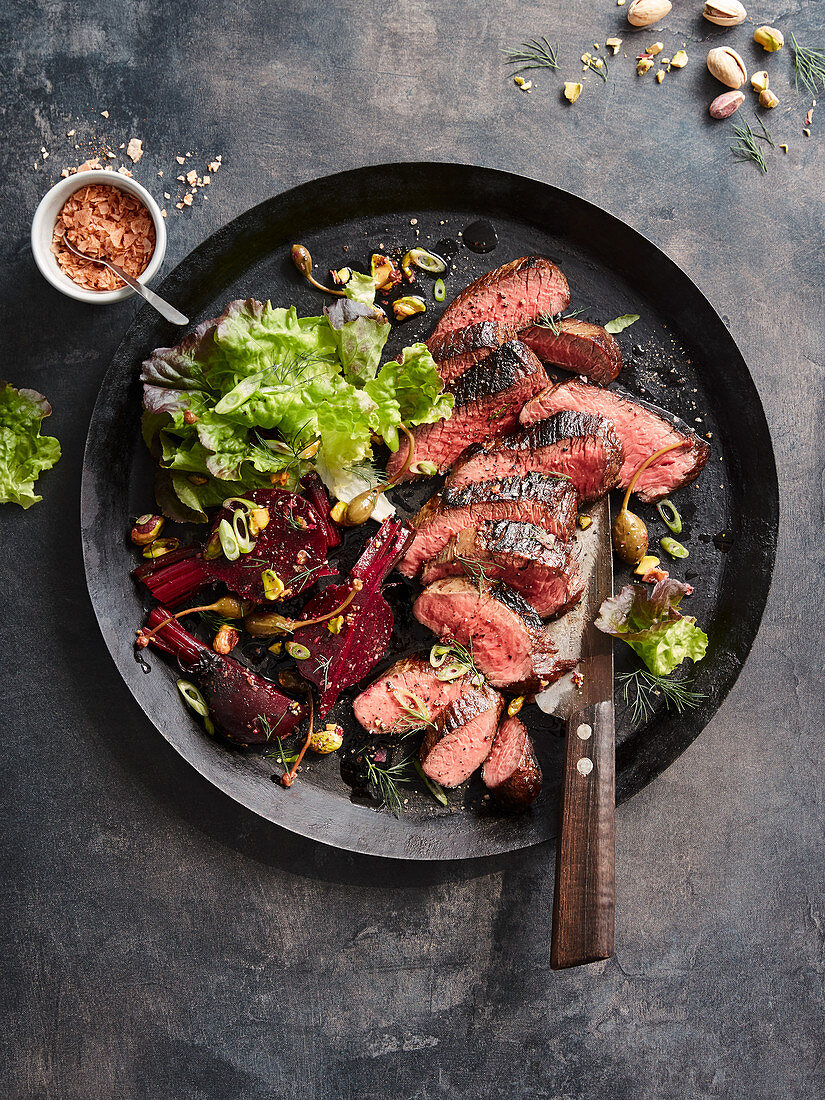 Beef fillet with beetroot, capers and pistachios