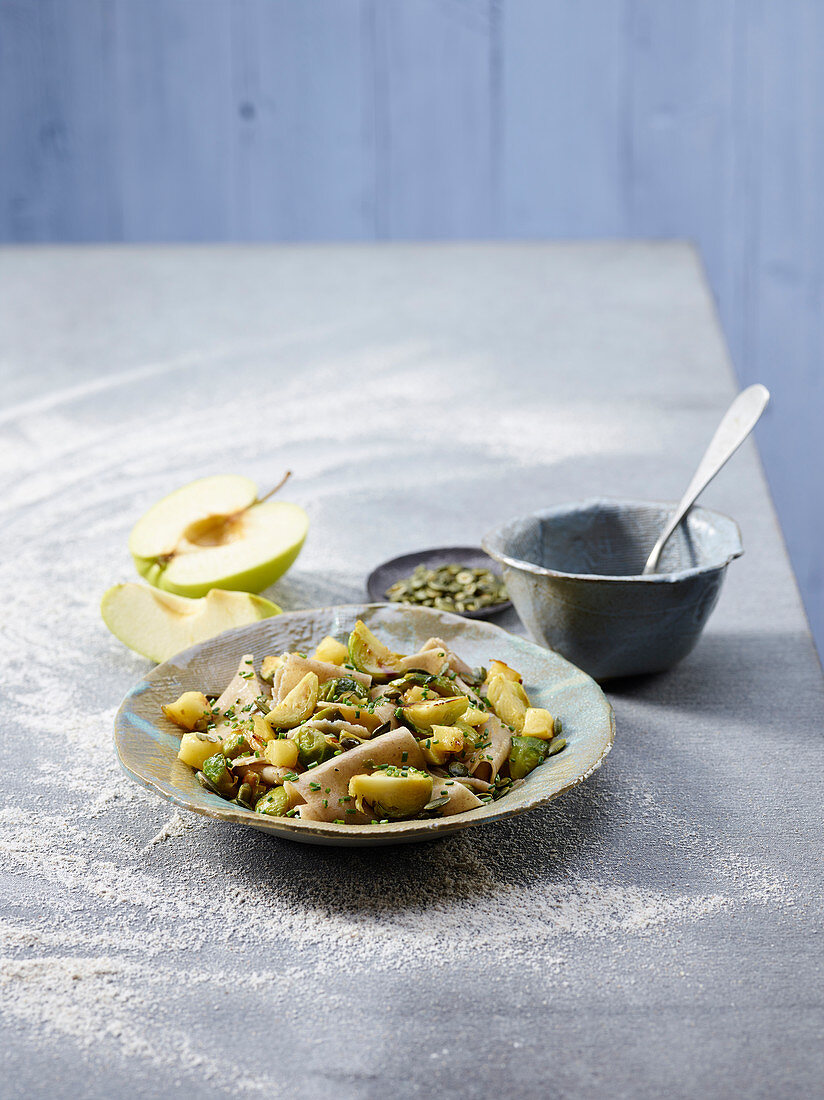 Rye pasta strips with brussels sprouts and apples