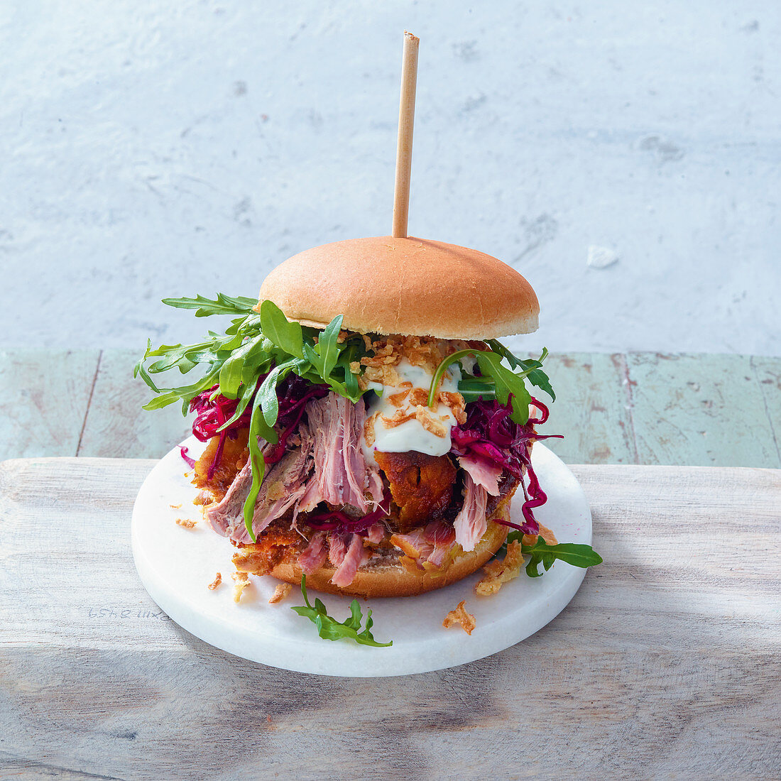 A grilled pulled beef burger with tarragon aioli