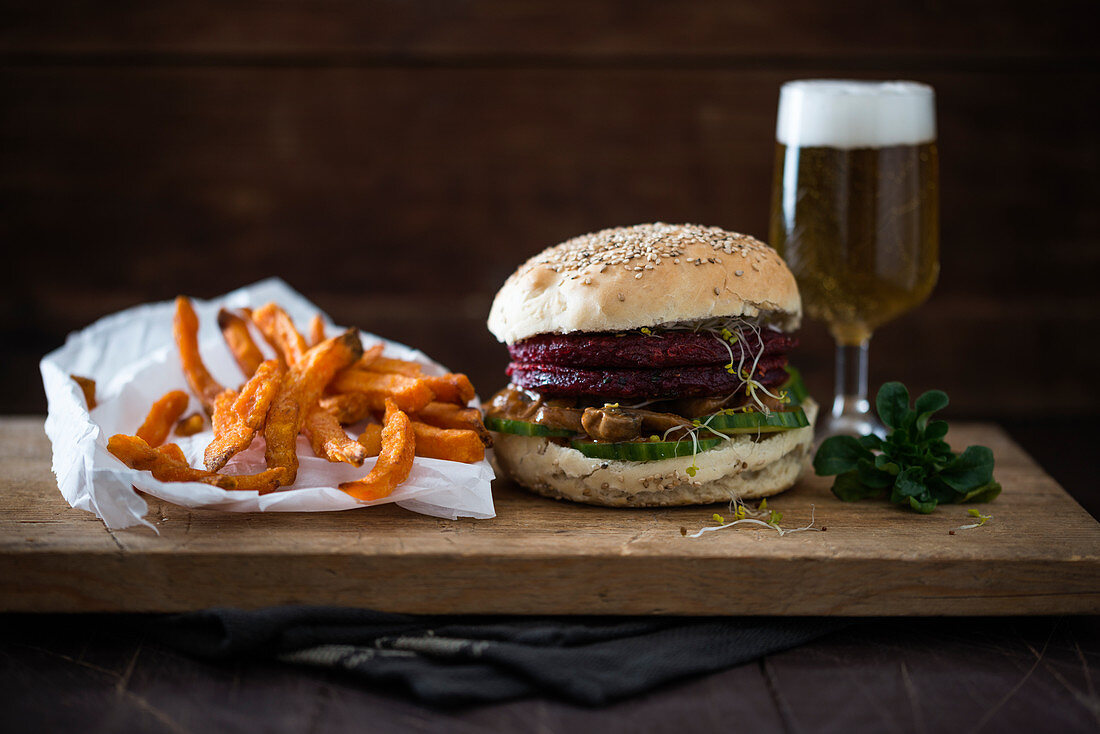 A vegan burger with beetroot and creamy mushrooms