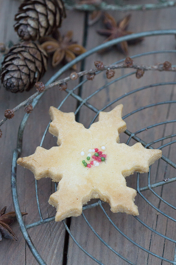 A snowflake biscuit on a cooling rack